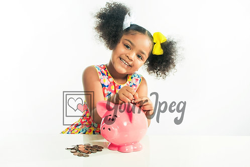 Girl putting money in piggy bank smiling
