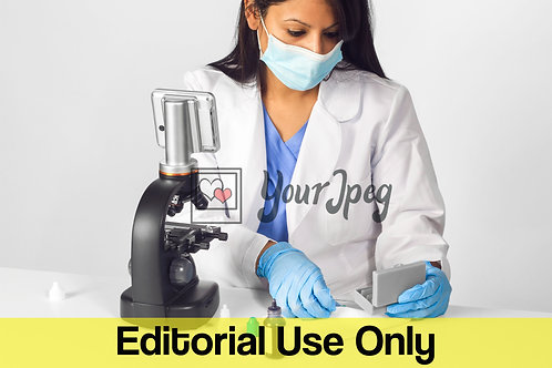 Female Doctor Wearing Mask And Gloves While Using Microscope Equipment #1