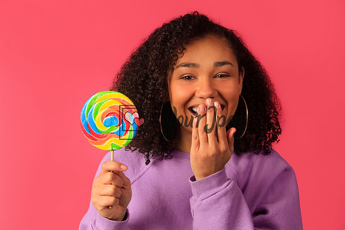 Woman With Hand Over Mouth While Holding Up Swirl Lollipop