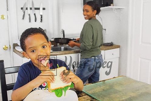 Boy smiling holding sandwich 7