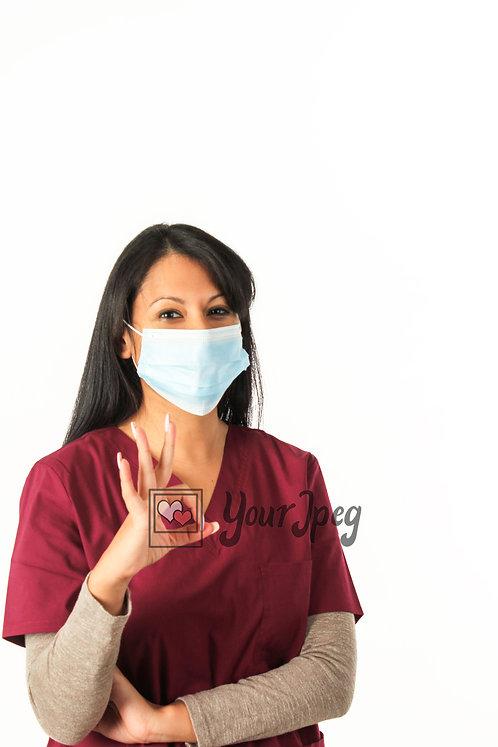 Female Nurse With Mask Holding Up Okay Hand Symbol Angled