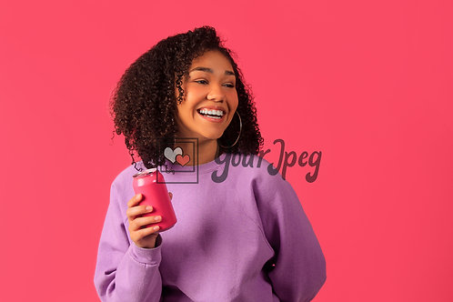 Woman Smiling While Holding Soda Can Looking Away
