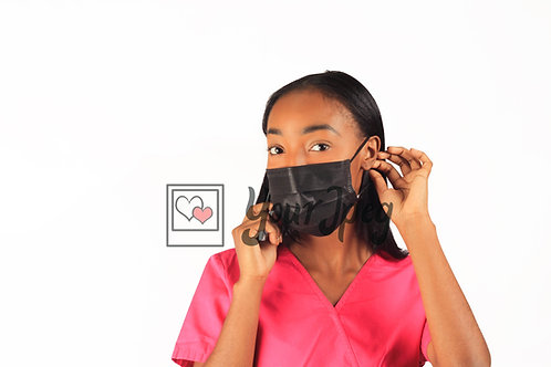 Female Nurse Adjusting Face Mask At Ears