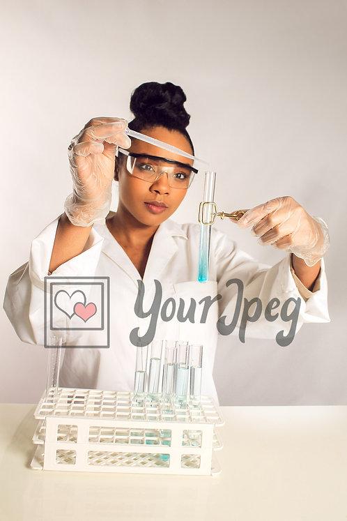 Female scientist working with liquid sample