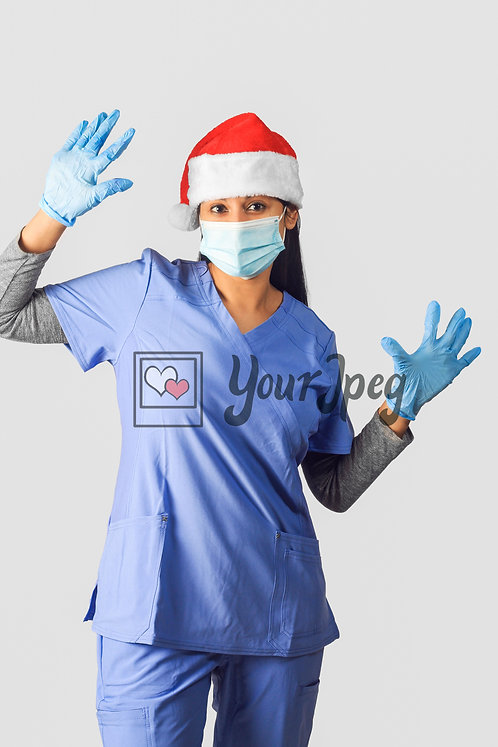 Female Nurse Wearing Christmas Hat, Gloves, And Mask With Hands Up