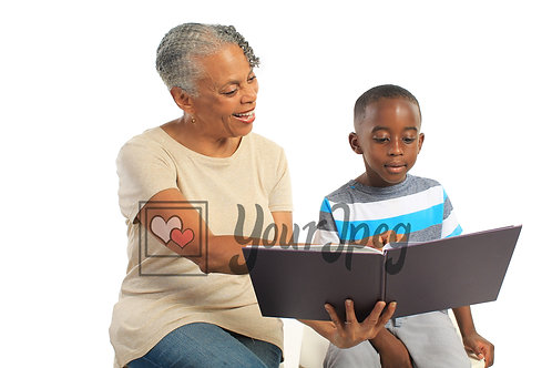 Older woman reading book to boy 2