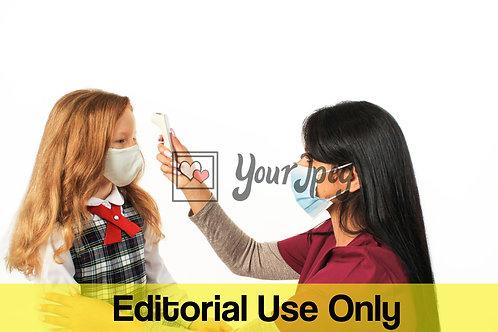 Female Nurse Taking Temperature *Editorial Only*