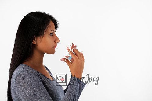 Woman Putting On Mask Side Angle