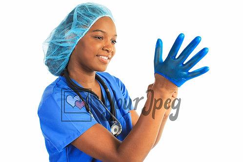 Woman putting on latex glove
