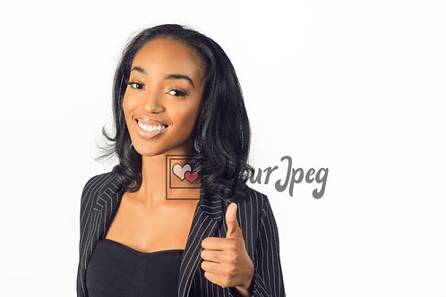 Woman In Suit Holding Up Thumbs Up Smiling