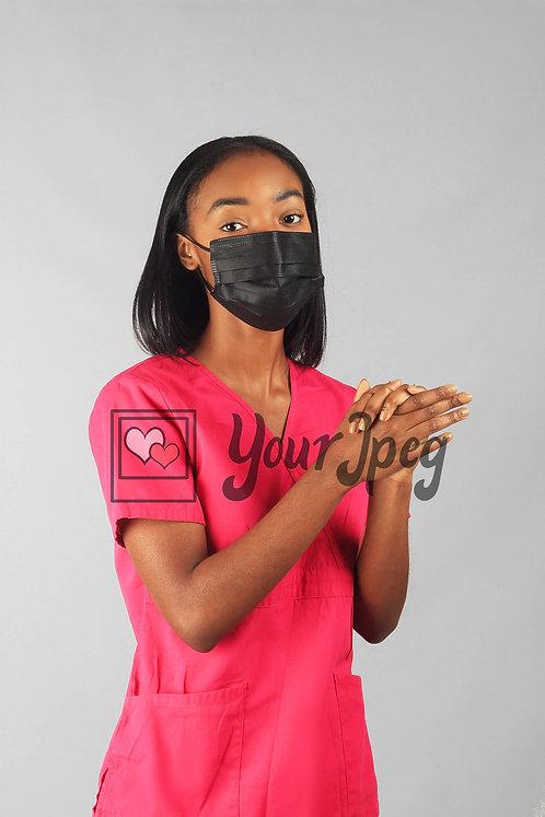 Female Nurse Demonstrating Hand Washing While Wearing Mask