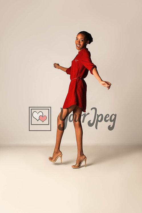 Model Posing With Arms Bent While Kicking Leg