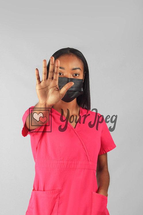Female Nurse Gesturing Stop While Wearing Mask