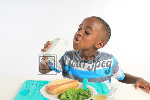 Boy at lunch drinking milk