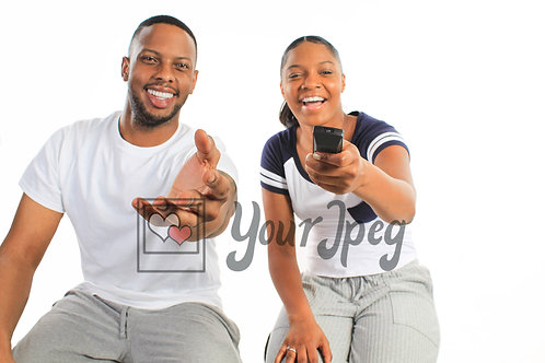 Couple watching TV pointing