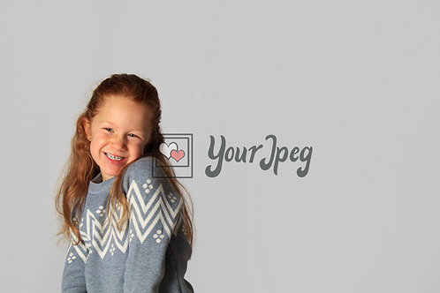 Young Girl Smiling While Posing For Camera