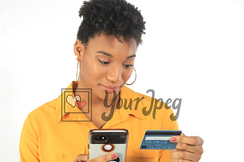 Woman making a call while holding a credit card