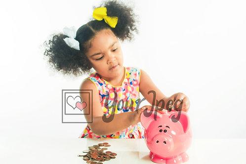 Girl putting money in piggy bank