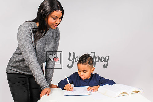 Young mom looking at son doing homework
