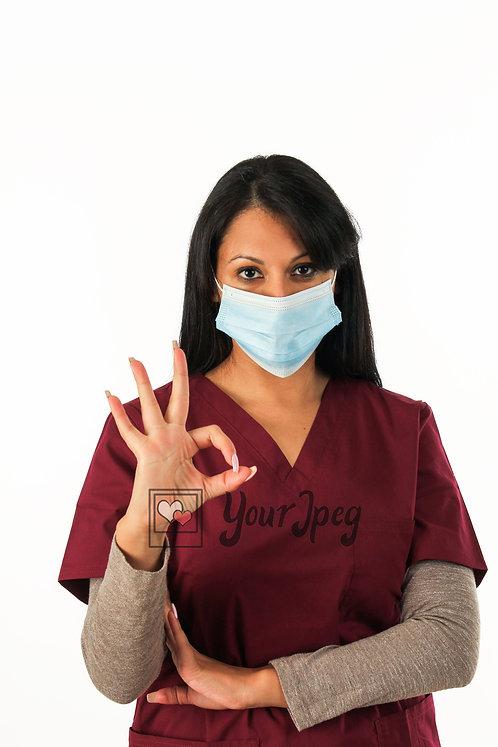 Female Nurse With Okay Hand Symbol Close Up