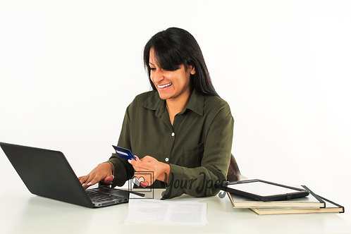 Woman Holding Credit Card While Looking At Laptop Smiling