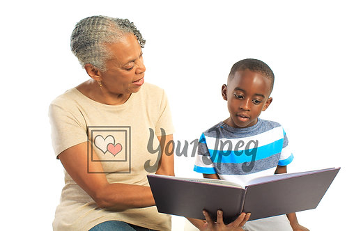 Grand mom and grandson reading book
