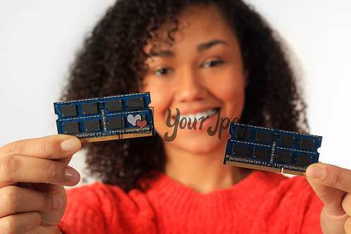 Woman Holding Up Computer Chip #2