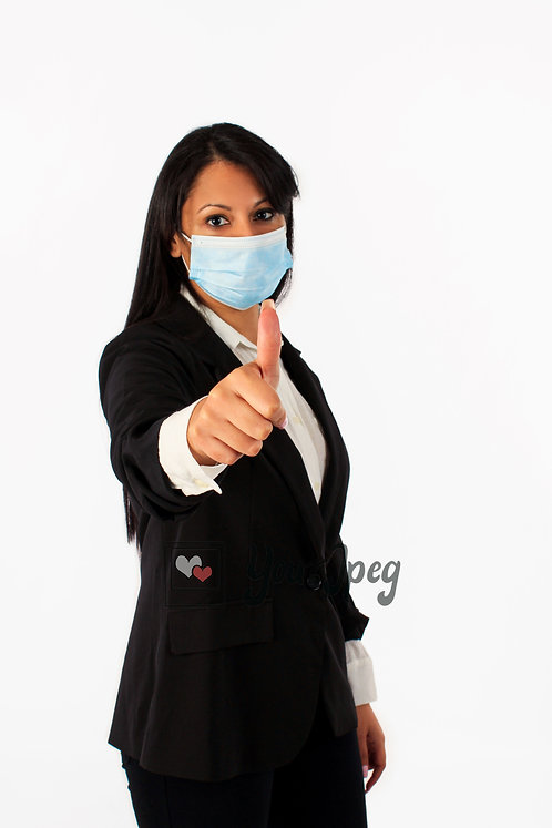 Woman In Suit Wearing Mask With Thumbs Up