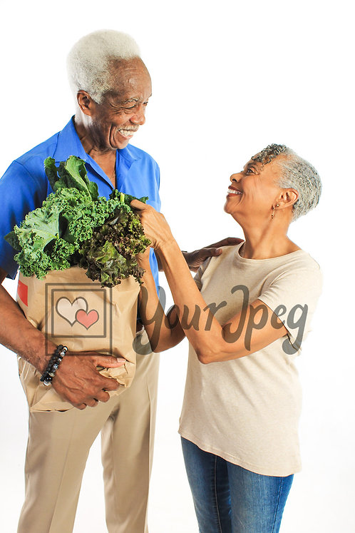 Senior couple with groceries