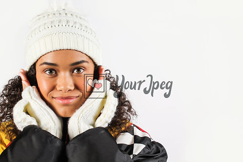 Teen girl with gloves and hat holding hands to face