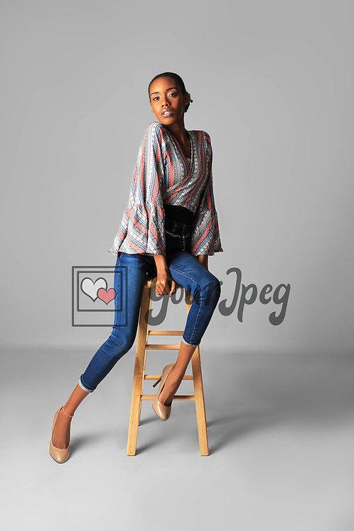 Model Sitting On Stool Facing Forward