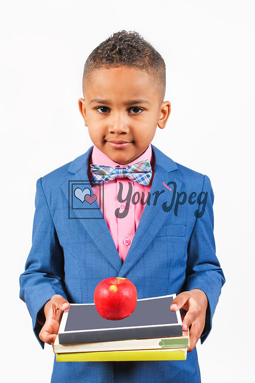 Boy wearing suit holding books and apple