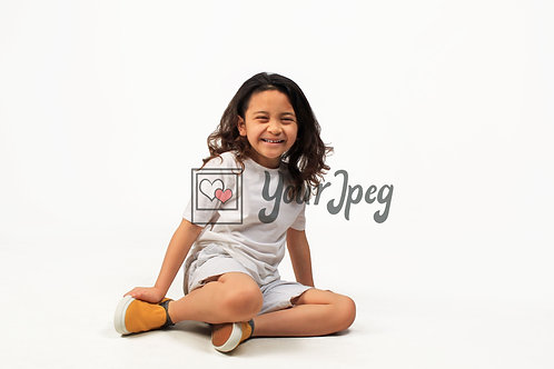 Boy Smiling While Sitting On Floor