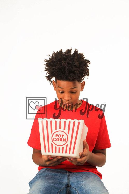 Teen Boy Looking Into Popcorn Bucket