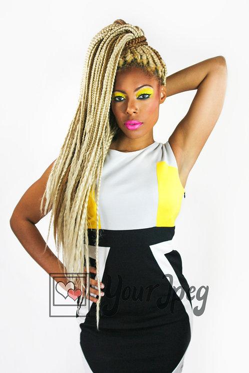 Woman with blonde braids posing