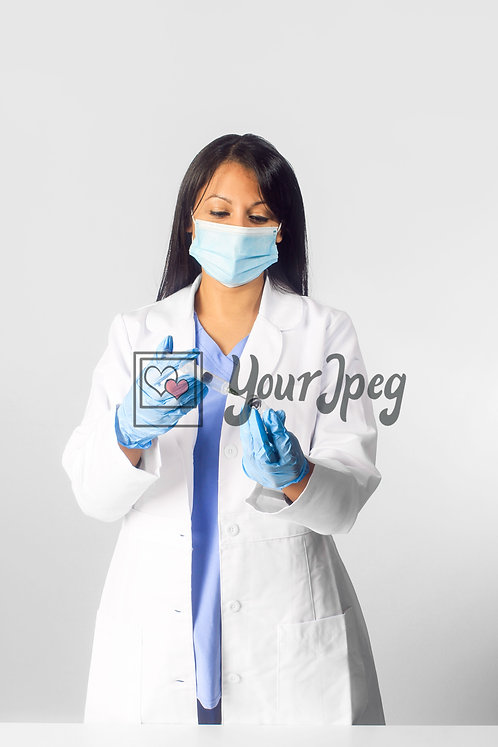 Female Doctor Wearing Mask With Syringe And Vial #2