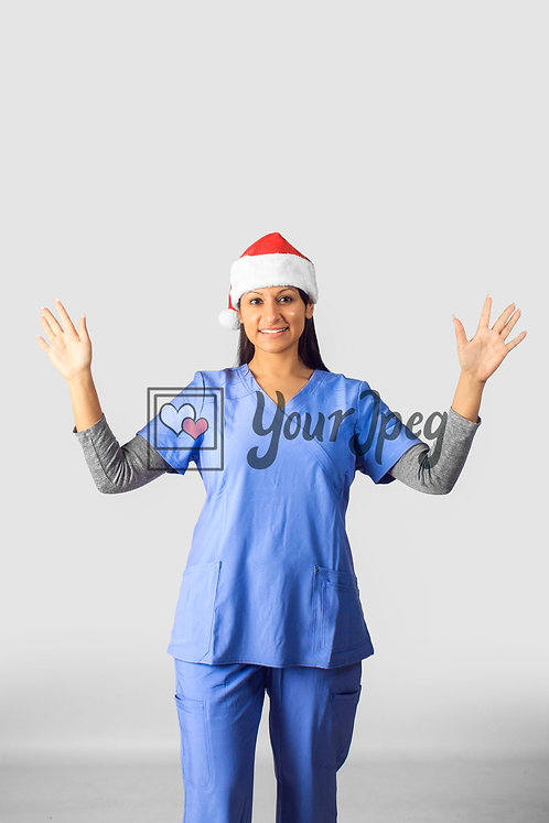 Female Nurse Wearing Christmas Hat With Hands Up