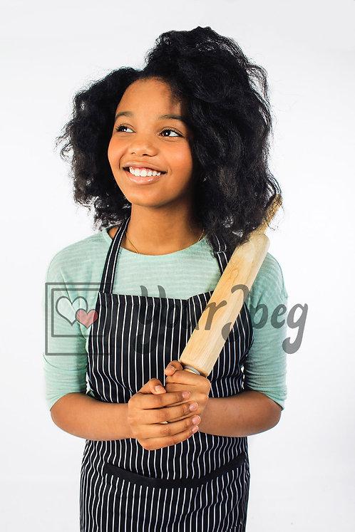 Tween cook smiling