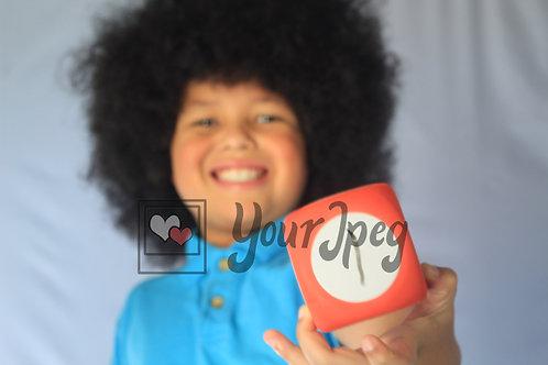 Little boy holding cube