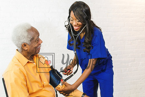 Woman taking senior patient's blood pressure