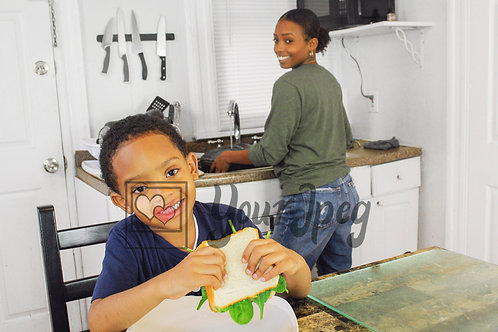 Boy smiling holding sandwich 8