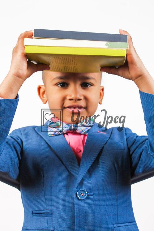 Boy holding up books