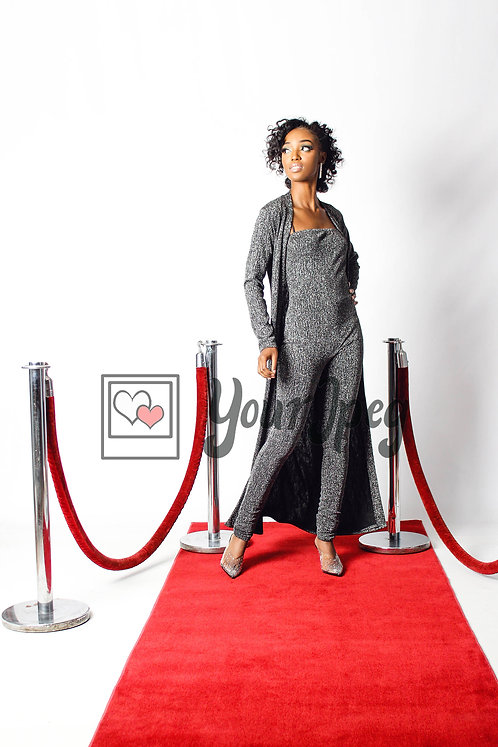 Woman Posing On Red Carpet With Her Hand On Her Hip While Looking Away