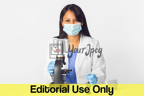 Female Doctor Wearing Mask And Gloves While Using Microscope #2