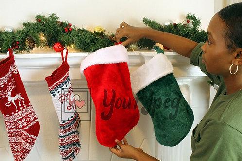 Woman putting up Christmas stocking