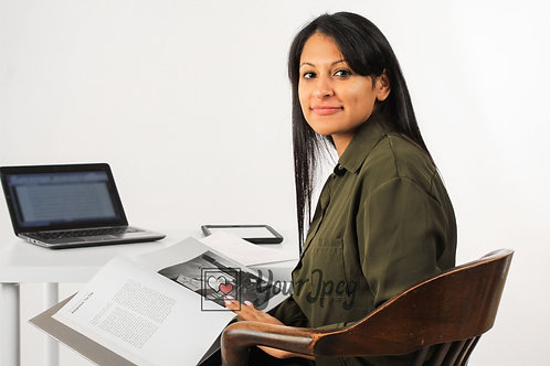 Woman Sitting At Desk Reading Book