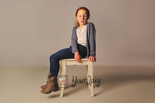 Girl Sitting On Table Modeling Side Angle