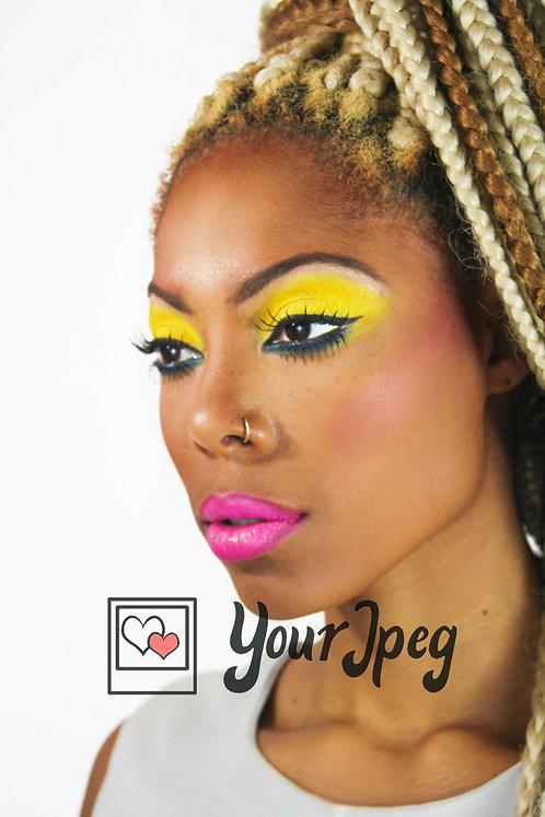 glamour shot profile of woman wearing bright makeup