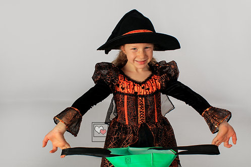 Young Girl in Halloween Costume smiling