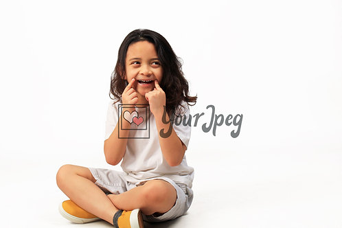 Boy Smiling With Hands On Corners of mouth